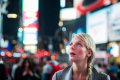 Impressed Woman in the Middle of Times Square. At Night stock image