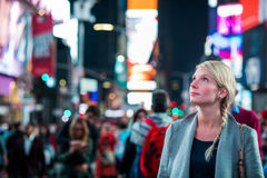 Impressed Woman in the Middle of Times Square. At Night royalty free stock photos