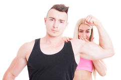 Impressed woman by personal trainer muscles Stock Image