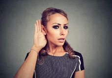 Concentrated woman listening to rumors royalty free stock photos
