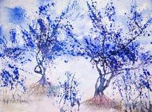 Impression of blue trees against a light blue sky. Stock Photos