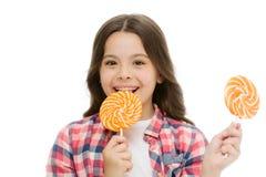 Impression de la nutrition de sucre de fait Sucrerie de sourire de lucette de prises d'enfant de fille L'enfant de fille avec la  photo libre de droits