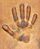 Impression de main sur une prise de masse images libres de droits