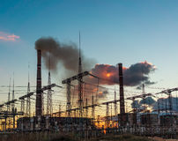 Impression network at transformer station in sunrise, high voltage up to yellow sky take with yellow tone. Royalty Free Stock Photography