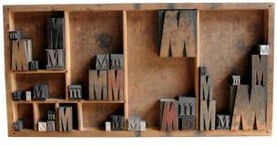 Impression typographique M dans le bois et le méta Images libres de droits