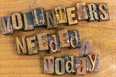 Impression typographique nécessaire en bois d'aujourd'hui de volontaires Photographie stock