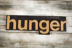 Impression typographique Word de faim sur le fond en bois photo stock