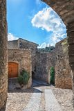 Impression of the village Viviers with the Virgin Mary statue on. The mountain top in the Ardeche region of France Stock Images