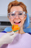 Impression. Woman in dentist chair with dental impression tray in her mouth stock images