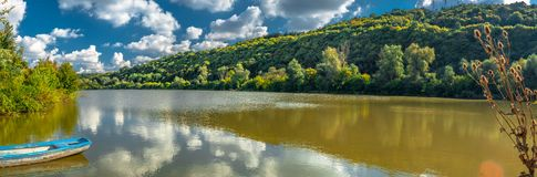 The boat on lake. Impressionistic oil painting digital art work - Rusenski Lom Nature Park, Rusenski Lom River, Ruse district, Bulgaria Stock Photo