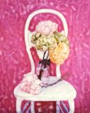 Impressionistic still life. This is a polaroid manipulation of hydrandeas on a chair. Paintery look and feel Stock Photography