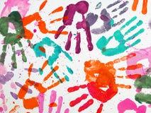 Impressions colorées de mains Photo stock