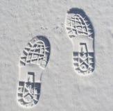 Impressions de pied dans la neige Images stock