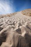 Impressions de pied de dune de sable Image libre de droits