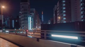 Impressive aerial time lapse view on busy traffic urban highway road in bright night light modern downtown architecture. Impressive aerial timelapse view on busy stock video footage