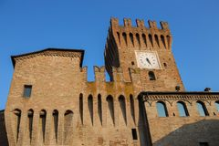 Impressive ancient fortress with clock tower in Spilamberto. Italy Royalty Free Stock Photo