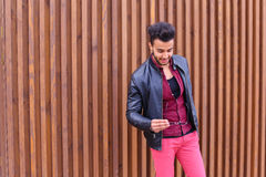 Impressive Arabic Young Guy Examines And Corrects Glasses Jacket Stock Images