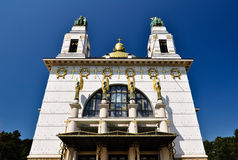 Impressive art deco church with golden cuppola. Art deco church in vienna with golden cuppola in front of blue sky Royalty Free Stock Photo