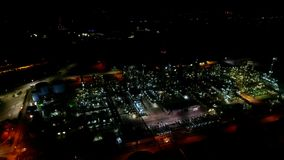 Impressive big modern ecology energy power station in bright night light illumination in wonderful aerial drone 4k view
