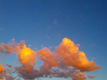 Impressive colorful clouds background. Impressive colorful clouds on evening sky royalty free stock photography