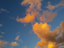 Impressive colorful clouds background. Impressive colorful clouds on evening sky stock photography