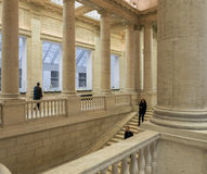 Impressive Columns and Stairway inside of the Asian Museum of Ar. SAN FRANCISCO, CA - DECEMBER 6, 2015: The Asian Art Museum of San Francisco houses one of the Stock Images