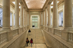 Impressive Columns and Stairway inside of the Asian Museum of Ar. SAN FRANCISCO, CA - DECEMBER 6, 2015: The Asian Art Museum of San Francisco houses one of the Stock Image