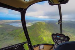 Amazing helicopter flight over mountains and lakes on the island of Kauai, Hawaii royalty free stock photography