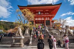 The impressive entry to Kiyomizu-dera buddhist temple in Kyoto, Japan. Kyoto, Japan - November 2, 2018: Happy People taking pictures and visiting the iconic stock photo