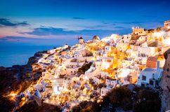 Impressive Evening View Of Santorini Island. Picturesque Spring Sunset On The Famous Greek Resort Oia, Greece, Europe. Traveling Stock Photography