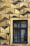 Impressive facade wall with Windows. Impressive facade wall with yellow and broun parallel and conner texture with big Windows Stock Photo