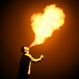 Impressive fire show. Fire show artist breathe fire in the night. Amazing fire performance. Vector illustration Royalty Free Stock Photo
