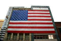 Impressive Flag. Large american flag drapped across two buildings Stock Photos