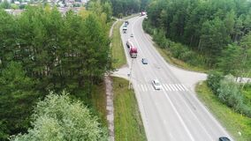 View from the quadcopter, column movement forward, turn, shipping, road, highway, camera movement from left to right.