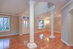 Impressive grand entry with very high ceiling and a lot of light. Impressive grand entry with very high ceiling, white columns, a lot of light and polished stock image