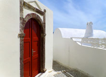 Impressive Greek Style Door Casing with Deep Red Door on Pure White Building at Santorini Royalty Free Stock Photos