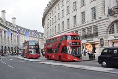 The impressive hallmark of London. The hallmark of London is undoubtedly the red bus , that adds color to the city royalty free stock photos