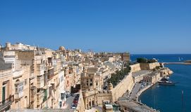 Landscape of Medieval architecture of Valletta, Malta. Impressive landscape of Medieval architecture of Valletta, at Malta, with stoned city palaces and defense Royalty Free Stock Images