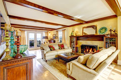 Impressive living room with ceiling beams and fireplace Royalty Free Stock Photos
