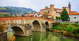Impressive medieval Bormida monastery and castle in regione Asti in Piemonte, Italy. Beautiful Bormida monastery,view with old bridge and castle,Piemonte ,italy stock photos