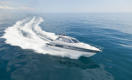 Motorboat sailing in the sea royalty free stock images