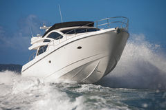 Motor yacht cutting through waves Stock Image