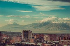 Impressive mount Ararat background. Yerevan cityscape. Travel to Armenia. Tourism industry. Cloudy sky. Armenian architecture. Cit Stock Photo