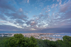 Impressive Palma, Majorca, Spain. Shot from bellver castle. Cloudy sky at dusk over Palma in Majorca island, shot from bellver castle, Spain Stock Photo