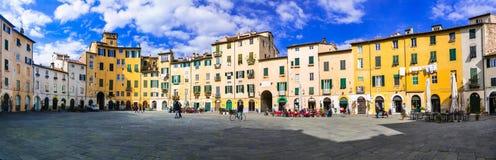 Beautiful colorful square - Piazza dell Anfiteatro in Lucca. Tus Stock Image