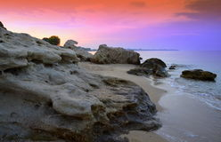 Impressive purple rocky beach Royalty Free Stock Image