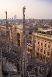 Vertical view from the Duomo rooftop of the Palazzo Settentrionale at sunset. The impressive rooftop view of the city of Milan is even more stunning at sunset stock photography
