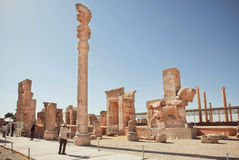 Impressive ruins of Persepolis and tourists making photopictures of ancient city Royalty Free Stock Image
