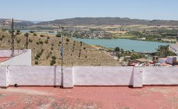 Impressive sight of Lagar reservoir from Arcos de la Frontera terrace, Cadiz, Andalusia, Spain. This white village is settled on cliff over Guadalete river stock images