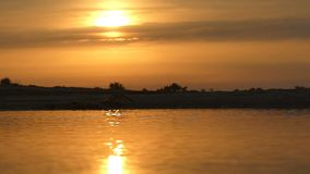 Impressive skyscape with golden sunset on Dzharylhach island in slo-mo